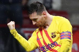 Leo Messi celebra su noveno gol en el campeonato español de primera división. Foto AP