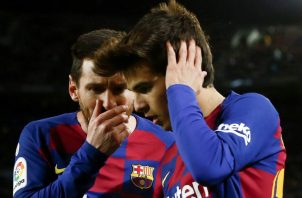 Messi y Ricard Puig. Foto:EFE