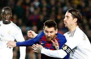 Messi del Barcelona y Sergio Ramos de Real Madrid. Foto:AP