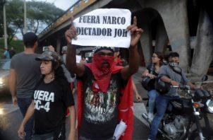 Las protestas contra el presidente hondureño se han intensificado. Foto: EFE.