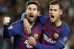 Philippe Coutinho celebra un gol con Messi. Foto EFE