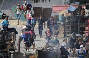 Se estima que más de 20 personas han perdido la vida en las protestas antigubernamentales de las últimas horas. FOTO/AP