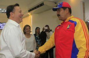 Juan Carlos Varela y Nicolás Maduro.