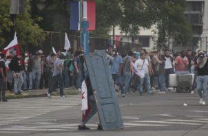 La Policía Nacional detuvo a 11 extranjeros en el segundo día consecutivos de protestas en rechazo a las reformas constitucionales. Foto Víctor Arosemena