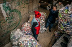 Economía de la calle cuenta con recolección de latas. Foto / Andrew Seng para The New York Times.