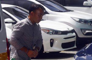 Tony NG, a su ingreso ayer al Sistema Penal Acusatorio, para la audiencia de apelación en la que se confirmó su detención provisional. Edward Santos