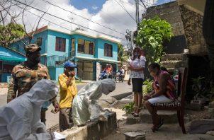 La reconstrucción en el Caribe ha sido retrasada por la llegada del coronavirus. Pruebas del virus en la República Dominicana. Foto / Erika Santelices/Agence France-Presse — Getty Images.
