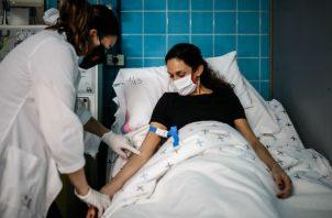 El ensayo de fase 2/3, ya ha comenzado en un sanatorio de Buenos Aires, Fotos: EFE