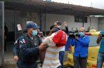 """Autoridades policiales conducen al tercer presunto implocado en la masacre del """"Búnker"""" de Espinar. Foto/Diomede Sánchez"""